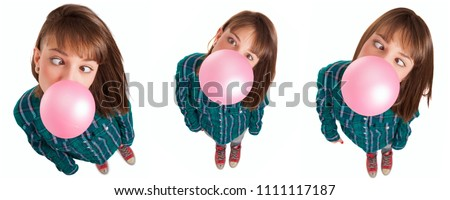 Beautiful young woman on high angle wearing shirt gesturing, smiling and doing silly face while chewing gum #1111117187