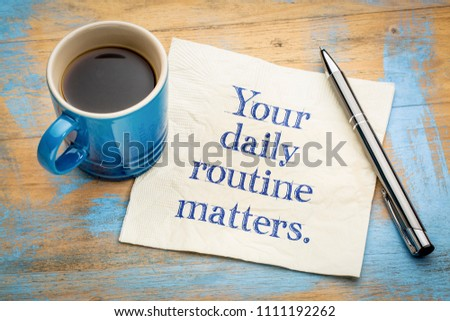 Your daily routine matters - handwriitng on napkin with a cup of coffee #1111192262