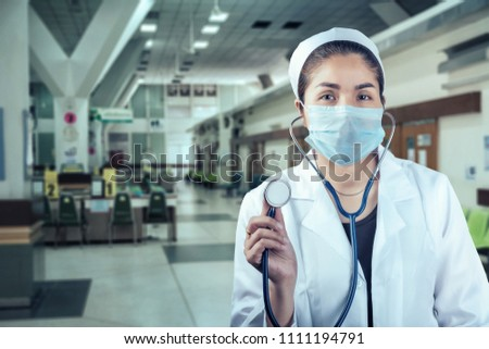 woman doctor in a blur room in a hospital background #1111194791