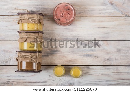 Honey in a glass jar on a light wooden background. Bee Honey #1111225070