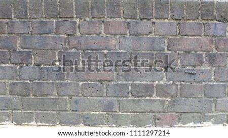 Old English brick wall. Texture background. City walls. Abstract street. #1111297214