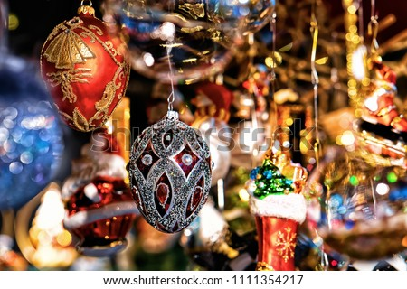 Glass Christmas Tree Decorations in Night Market on Gendarmenmarkt in Winter Berlin, Germany. Advent Fair and Bazaar Stalls with Craft Items. #1111354217