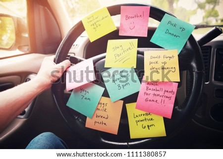 Steering wheel covered in notes as a reminder of errands to do Royalty-Free Stock Photo #1111380857
