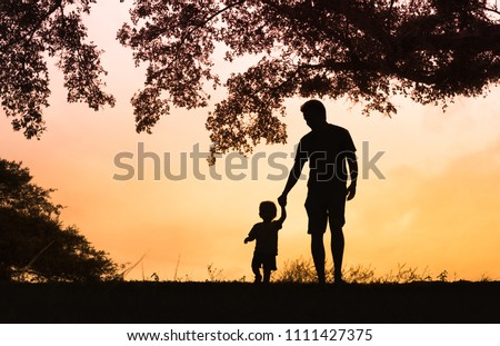Father son holding hands walking together. Childhood and parenting concept. Fathers Day concept  Royalty-Free Stock Photo #1111427375