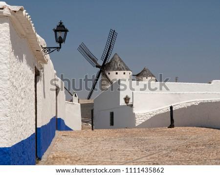 Streets of Campo de Criptana with windmills #1111435862