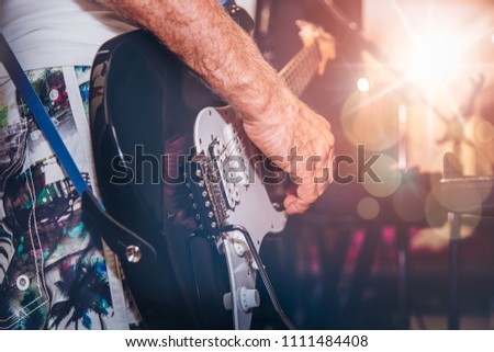 Stage lights.Abstract musical background.Playing guitar and concert concept.Live music background.Music festival.Instrument on stage and band #1111484408