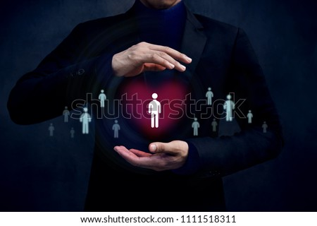 Customer Care Concept. Company Protect and Support thire Clients with Mind, Human icon on Heart shape inside a Protected Hands of Businessman #1111518311