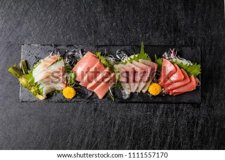 japanese foods sashimi (raw sliced fish, shellfish or crustaceans) #1111557170