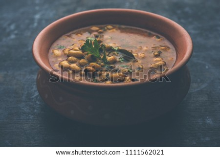 Black Eyed Kidney Beans Curry or Chawli chi usal / Barbati masala, served in a ceramic bowl over moody background, selective focus  #1111562021