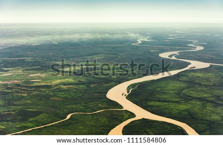 Landscape aerial view of colorful Amazon rivers, forest with trees, jungle, and fields Royalty-Free Stock Photo #1111584806