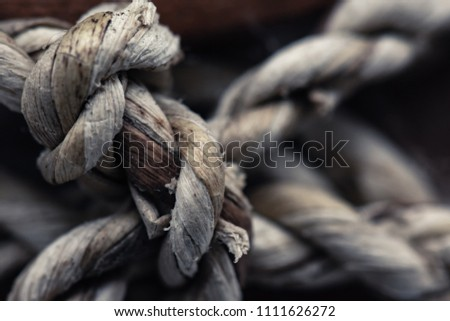 Close-up rope knots vintage rope on dark background. #1111626272