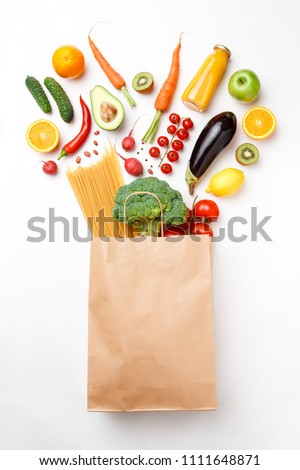 Photo of paper bag with vegetables, fruits and spaghetti