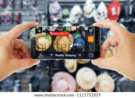 Augmented reality concept marketing in Store. Hand holding smart phone use AR application to shoping online, check information and promotion. #1111751819