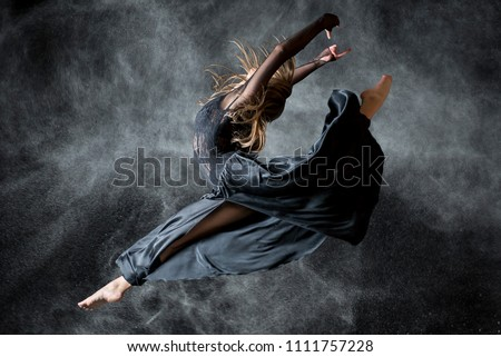 Dancer in the black background Royalty-Free Stock Photo #1111757228