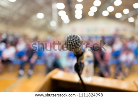 Close up of microphone on a podium in an auditorium #1111824998