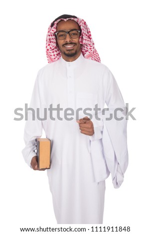 Khaleeji man wearing a thobe, holding a book and is coat going to the college, on his face big smile, isolated on white background. #1111911848