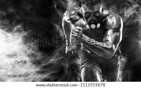 Strong athletic man sprinter in training mask, running, fitness and sport motivation. Runner concept with copy space. Dynamic movement. #1111919678