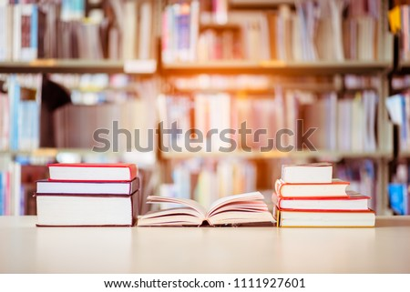 Book stack is placed on the library desk. education background, back to school concept. #1111927601