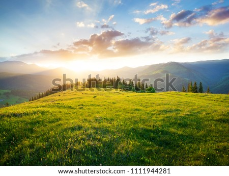 Sunset in the mountain valley. Beautiful natural landscape in the summer time #1111944281