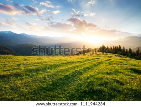 Sunset in the mountain valley. Beautiful natural landscape in the summer time #1111944284