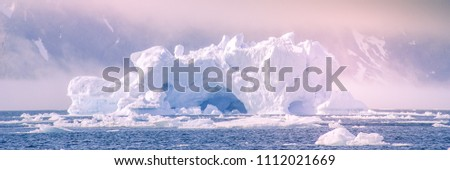 iceberg and climate change Banner Royalty-Free Stock Photo #1112021669