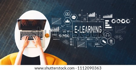 E-Learning with person using a laptop on a white table Royalty-Free Stock Photo #1112090363