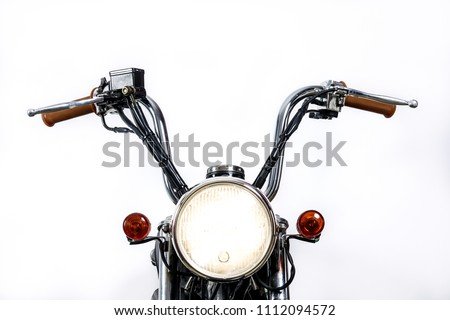 Close up of headlight on vintage motorcycle. Custom chopper / scrambler motocross. Retro motorbike on white background. Blank copy space for text. #1112094572