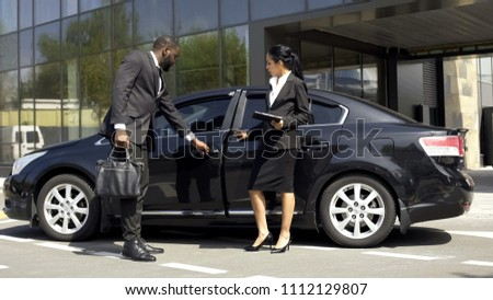 Car showroom consultant showing luxury car to buyer, vehicle leasing business #1112129807