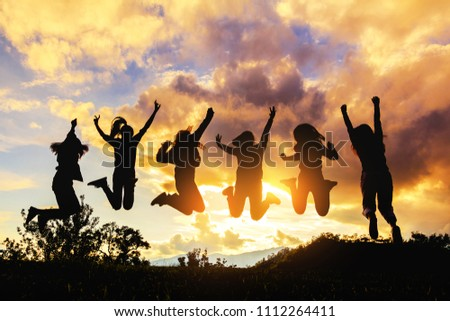 silhouette of friends girls group jumping playing at sunset time #1112264411