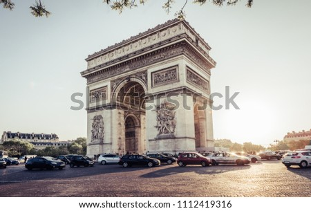 Paris Arc de Triomphe (Triumphal Arch) in Chaps Elysees at sunset, Paris, France. Architecture and landmark of Paris. Sunset Paris cityscape #1112419316