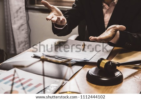 businessman or lawyers sitting office working discussing contract papers on wood table. Law of advisor Concepts and vintage, Sunset light.Selective Focus #1112444102