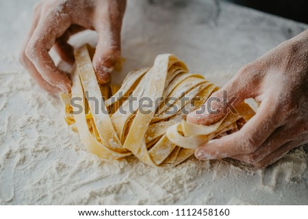 Closeup of process of making cooking homemade pasta. Chef make fresh italian traditional pasta  #1112458160