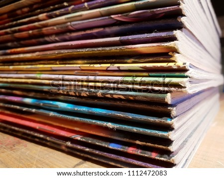 Comic books on a table in close view Royalty-Free Stock Photo #1112472083