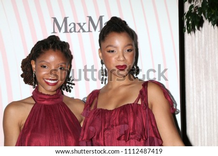 LOS ANGELES - JUN 13:  Chloe Bailey, Halle Bailey at the Women In Film 2018 Crystal + Lucy Awards at the Beverly Hilton Hotel on June 13, 2018 in Beverly Hills, CA #1112487419