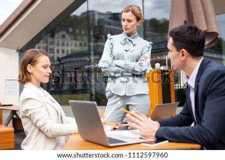 Business ideas. Blonde-haired executive feeling a little bit curious about new unexpected business ideas #1112597960