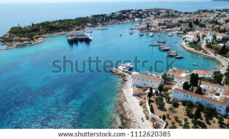 Aerial drone bird's eye view photo of picturesque church of Agios Nikolaos in historic and traditional island of Spetses, Saronic Gulf, Greece #1112620385