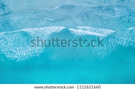Wave on the beach as a background. Beautiful natural background at the summer time #1112621660