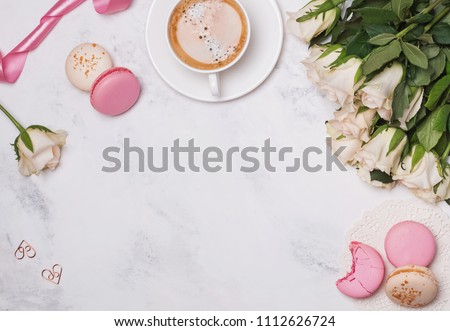 Stylish flat lay with macarons, coffee and roses #1112626724