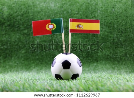 ball with Spain VS Portugal flag match on Green grass football 2018 #1112629967