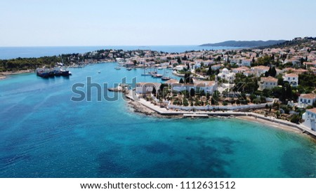 Aerial drone bird's eye view photo of picturesque church of Agios Nikolaos in historic and traditional island of Spetses, Saronic Gulf, Greece #1112631512