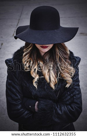 Mysterious girl with black hat and black jacket. #1112632355