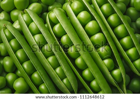 Green pea pods texture. Natural background #1112648612