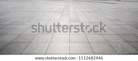 Perspective View of Monotone Gray Brick Stone on The Ground for Street Road. Sidewalk, Driveway, Pavers, Pavement in Vintage Design Flooring Square Pattern Texture Background #1112682446