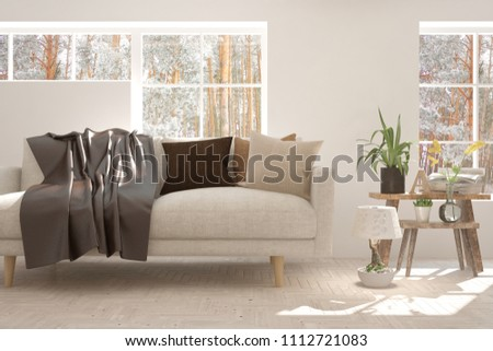 White room with sofa and winter landscape in window. Scandinavian interior design. 3D illustration #1112721083