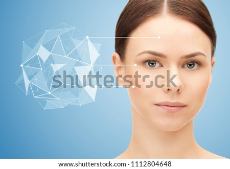 beauty, science and future technology concept - portrait of beautiful woman with low poly shape projection pointing to face over blue background #1112804648