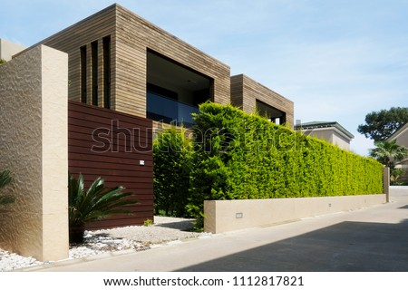 Modern houses with green plant wall. Actual eco architecture #1112817821