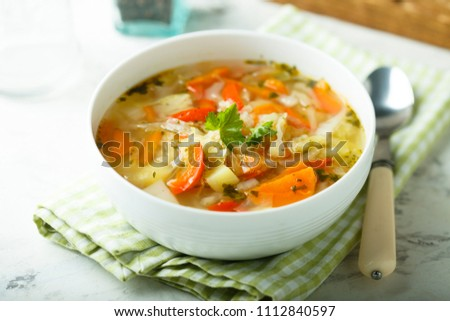 Fresh young cabbage soup with tomatoes, capsicum and carrot #1112840597