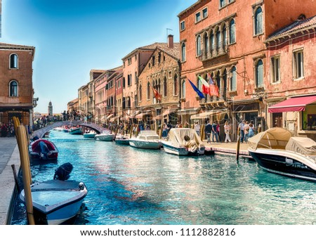 VENICE, ITALY - APRIL 30: View over the scenic canal Rio dei Vetrai on the island of Murano, Venice, Italy, April 30, 2018. The island is a popular attraction for tourists, famous for its glass making #1112882816