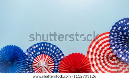July 4th theme paper fans on blue background. #1112903126