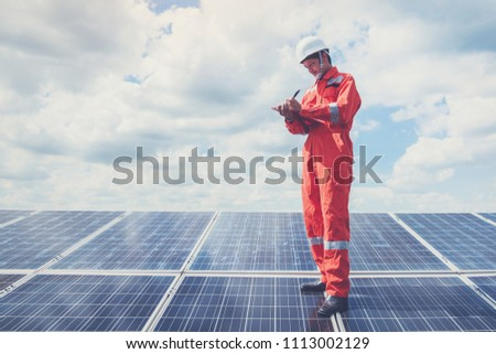 operation and maintenance in solar power plant ; engineering team working on checking and maintenance in solar power plant ,solar power plant to innovation of green energy for life #1113002129
